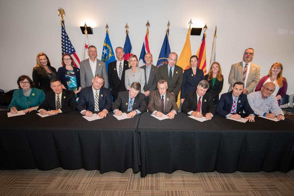 Jayne Harkins (seated, far left), as executive director of the Colorado River Commission of Nevada, was one of the signers in 2017 of domestic agreements that were part of Minute 323, the addendum to the 1944 U.S.-Mexican Water Treaty.