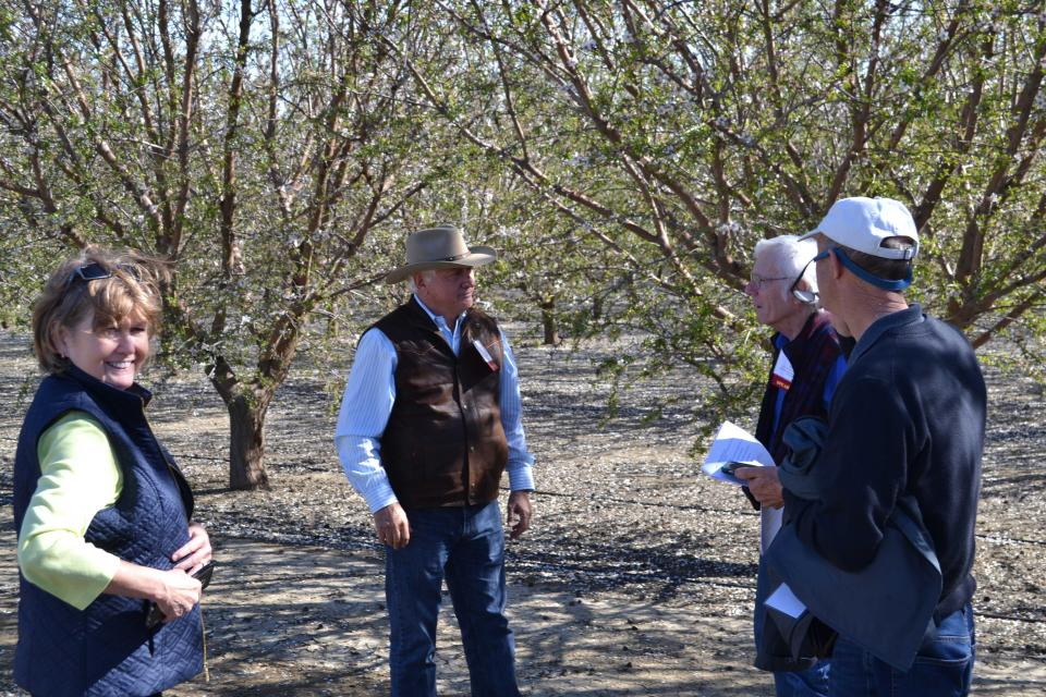Guests talk with farmer Joe Del Bosque on Central Valley Tour
